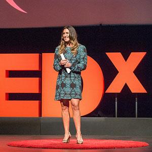 Lianne presenting a TEDx talk
